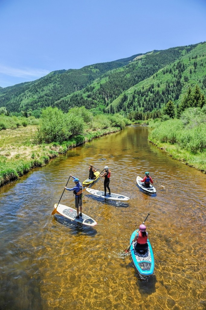 Stand up paddleboarding in the Roaring Fork River east of Aspen, Colorado.